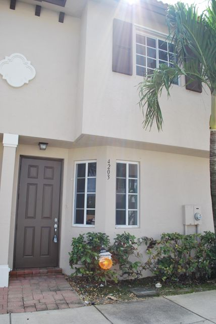 4203 Napoli Lake Drive , Riviera Beach FL 33410 is listed for sale as MLS Listing RX-10408322 31 photos