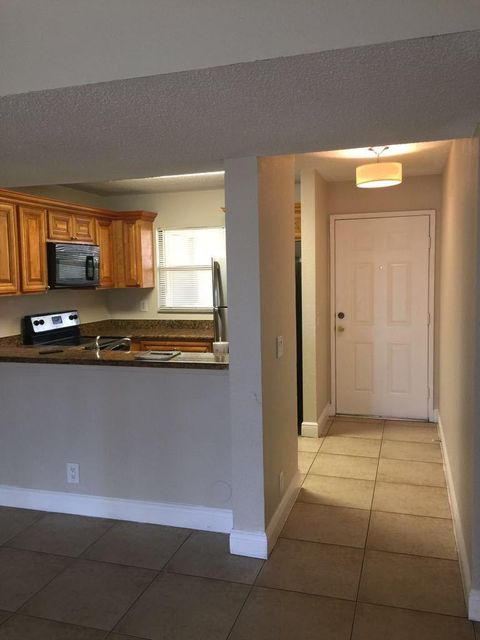 1421 Windorah Way F , West Palm Beach FL 33411 is listed for sale as MLS Listing RX-10409066 7 photos