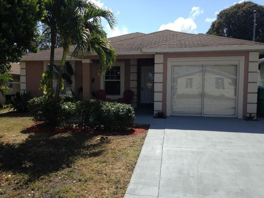 1449 Ac Evans Street , Riviera Beach FL 33404 is listed for sale as MLS Listing RX-10409511 5 photos
