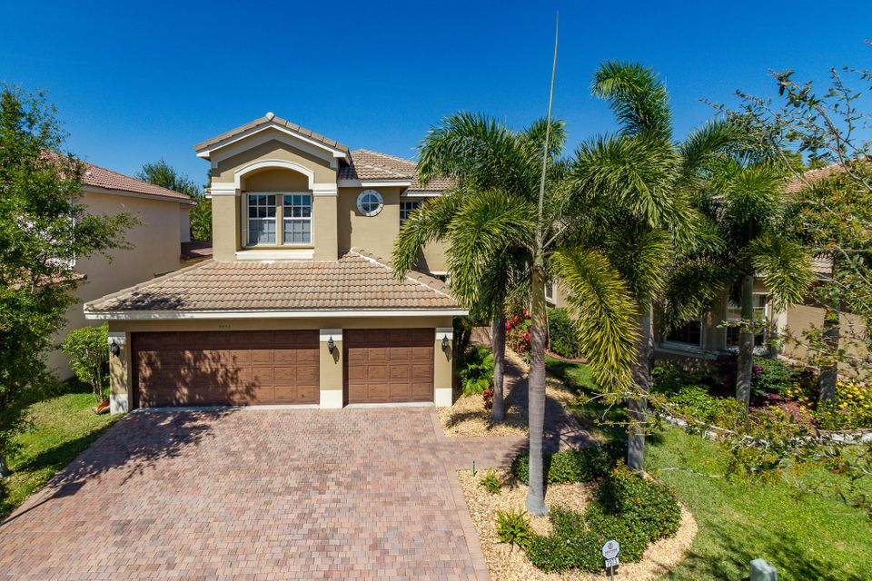 8691 Woodgrove Harbor Lane  is listed as MLS Listing RX-10383023