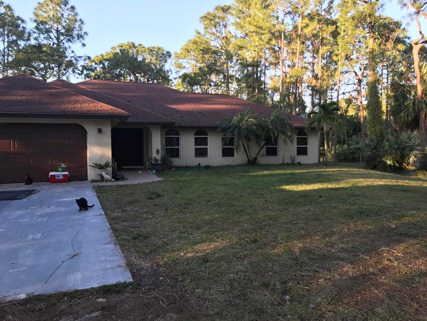Home for sale in ACREAGE + UNREC PLAT Loxahatchee Florida