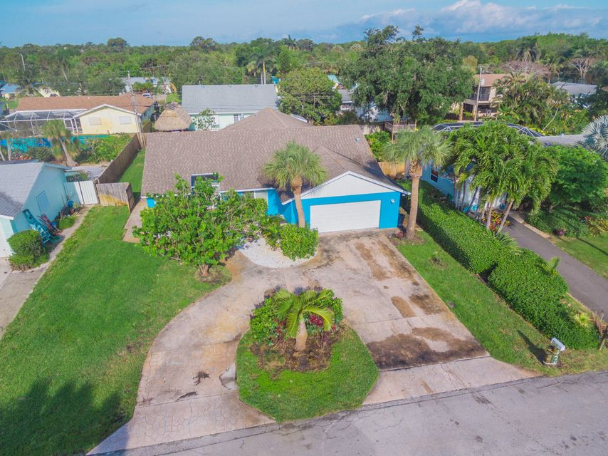 14297 Evelyn Drive , Palm Beach Gardens FL 33410 is listed for sale as MLS Listing RX-10422952 23 photos