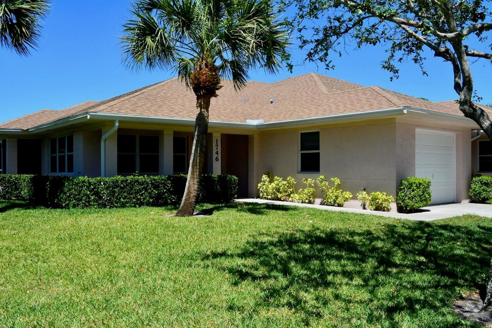 1746 N Dove Tail Drive is listed as MLS Listing RX-10423749 with 9 pictures