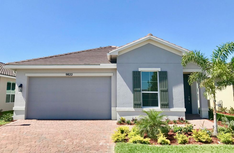 9822 SW Trumpet Tree Circle is listed as MLS Listing RX-10423931 with 22 pictures