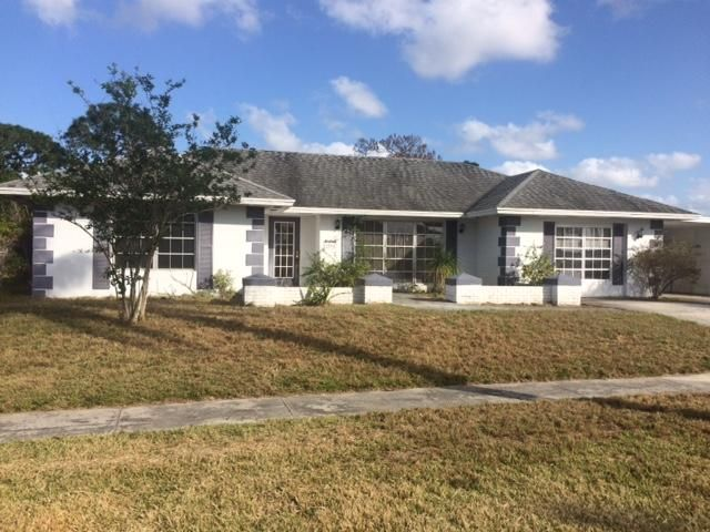 1862 SE Erwin Road is listed as MLS Listing RX-10423981 with 37 pictures