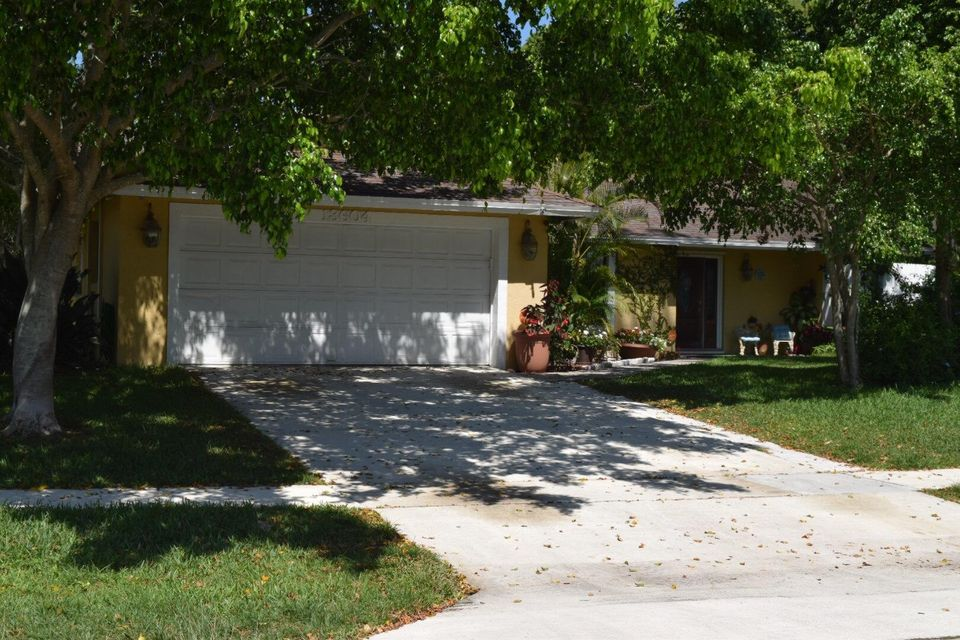 13604  Exotica Lane is listed as MLS Listing RX-10424564 with 15 pictures