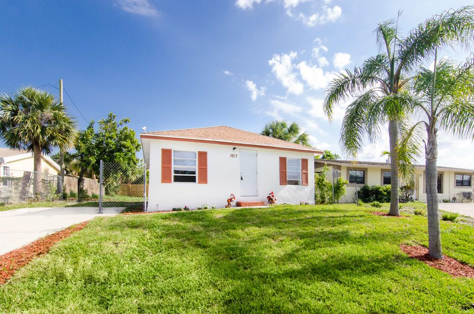 1617 W 34th Street , Riviera Beach FL 33404 is listed for sale as MLS Listing RX-10426279 11 photos