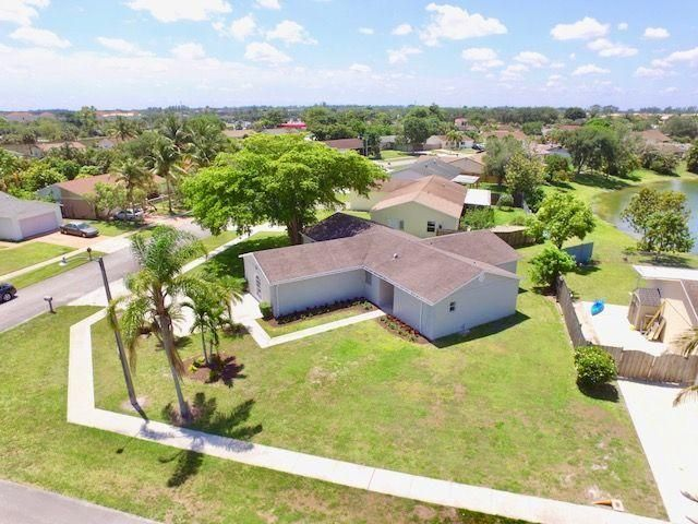 Home for sale in COUNTERPOINT ESTATES 4 Royal Palm Beach Florida