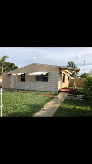 1052 W 26th Street , Riviera Beach FL 33404 is listed for sale as MLS Listing RX-10431156 16 photos