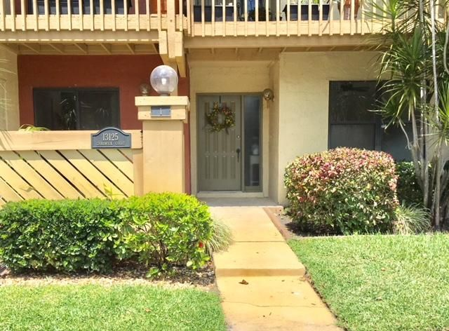 Home for sale in SHEFFIELD WOODS AT WELLINGTON COND BLDG 1 UNIT 1 Wellington Florida