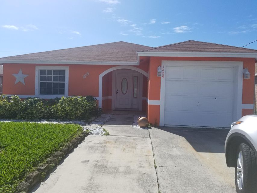 1409 W 35th Street , Riviera Beach FL 33404 is listed for sale as MLS Listing RX-10432131 1 photos