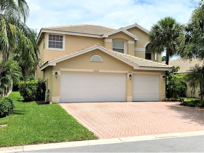 5029 Solar Point Drive , Greenacres FL 33463 is listed for sale as MLS Listing RX-10435459 53 photos