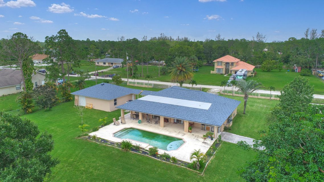Home for sale in Loxahatchee, the acreage Loxahatchee Florida