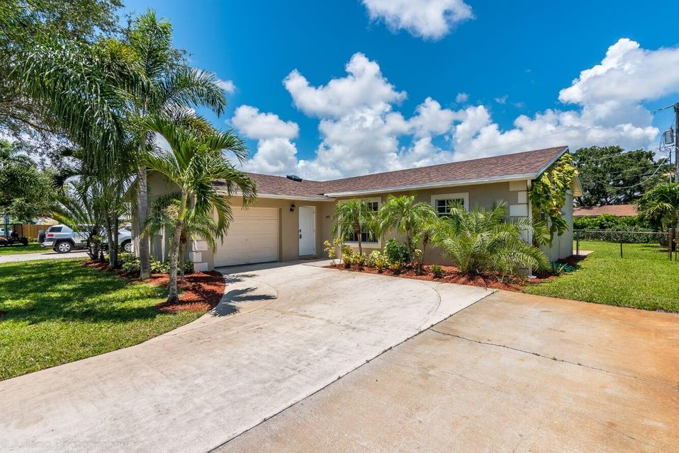 14341 Joan Drive , Palm Beach Gardens FL 33410 is listed for sale as MLS Listing RX-10441719 21 photos