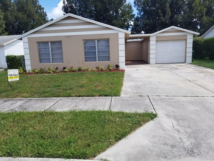 1244 W 27 Street , Riviera Beach FL 33404 is listed for sale as MLS Listing RX-10444334 26 photos