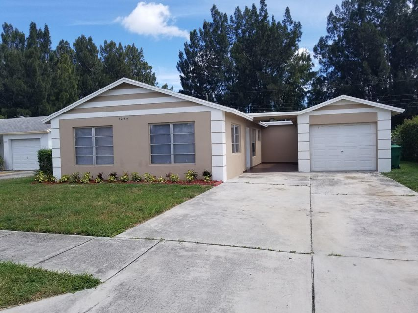 1244 W 27 Street , Riviera Beach FL 33404 is listed for sale as MLS Listing RX-10444334 25 photos