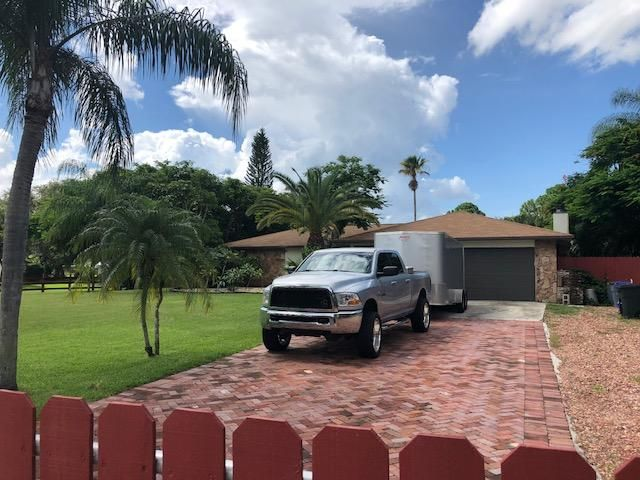 Palm Beach Country Estates home on 6799  149th Place