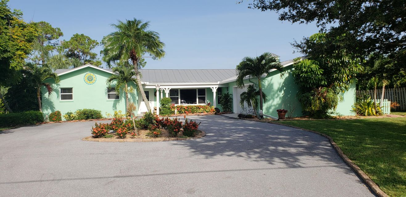 1234 NW Spruce Ridge Drive , Stuart FL 34994 is listed for sale as MLS Listing RX-10449393 30 photos