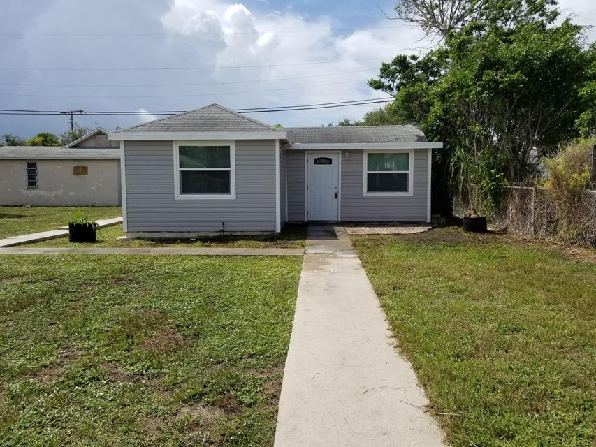 49 E 25th Street , Riviera Beach FL 33404 is listed for sale as MLS Listing RX-10454413 9 photos