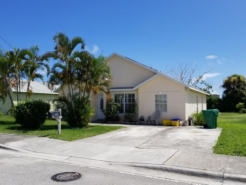 1249 W 34th Street , Riviera Beach FL 33404 is listed for sale as MLS Listing RX-10457279 5 photos