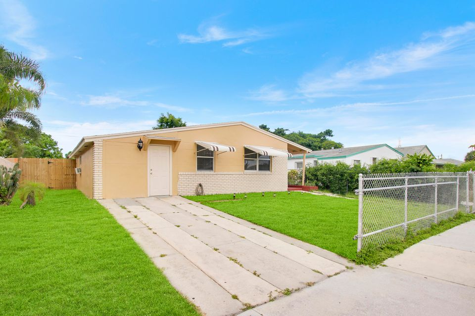 1052 W 26th Street , Riviera Beach FL 33404 is listed for sale as MLS Listing RX-10431156 15 photos