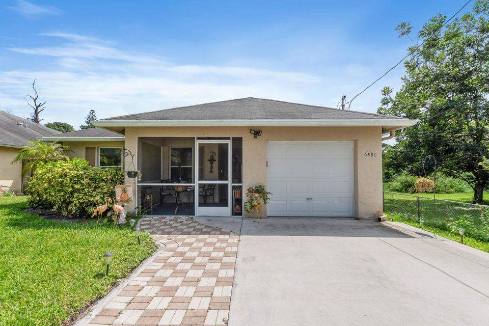 6880 Australian Street , Jupiter FL 33458 is listed for sale as MLS Listing RX-10460827 20 photos