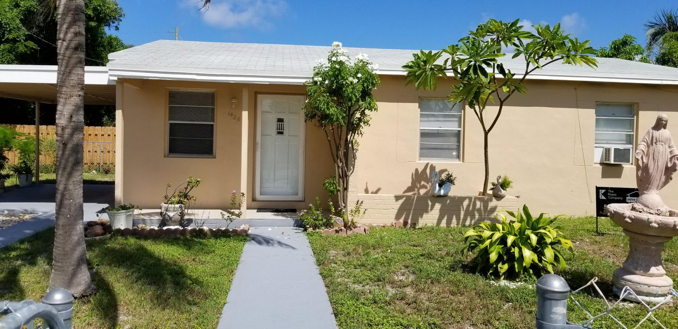 Home for sale in WHISPERING PALMS 4 Lake Worth Florida