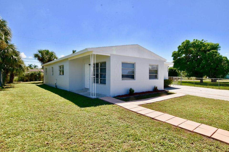 1155 W 27th Street , Riviera Beach FL 33404 is listed for sale as MLS Listing RX-10464961 12 photos