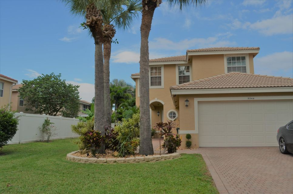 5544 Wishing Star Lane , Greenacres FL 33463 is listed for sale as MLS Listing RX-10465844 63 photos
