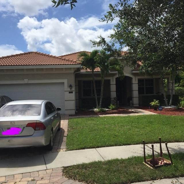 6705 Bulrush Court , Greenacres FL 33413 is listed for sale as MLS Listing RX-10469421 10 photos