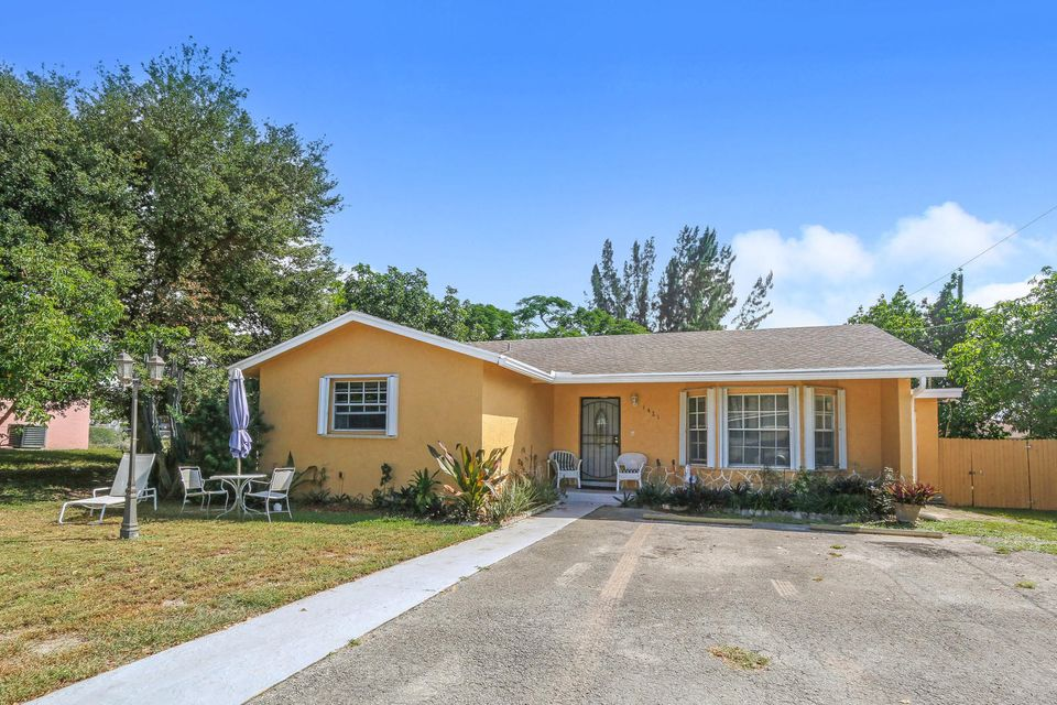 1421 W 26th Street , Riviera Beach FL 33404 is listed for sale as MLS Listing RX-10470735 19 photos