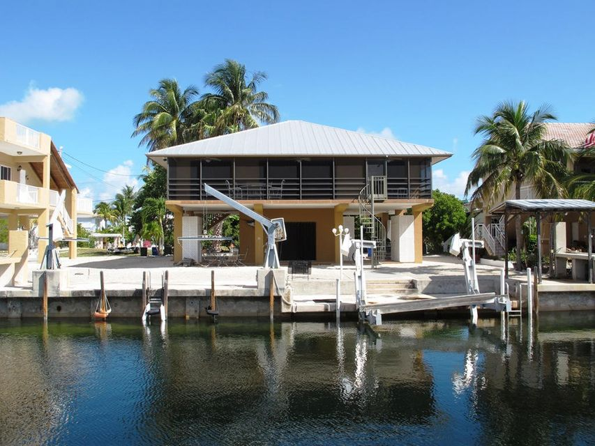 独户住宅 为 销售 在 109 MADEIRA Court 伊斯拉摩拉, 佛罗里达州 33036 美国