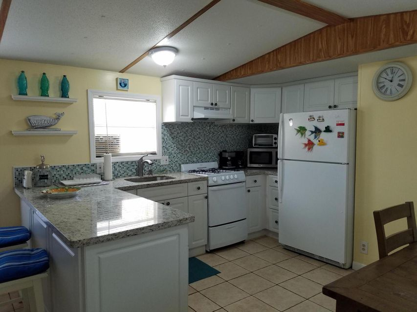Additional photo for property listing at 100 Tweedy Pie Terrace 100 Tweedy Pie Terrace Key Largo, Флорида 33037 Соединенные Штаты