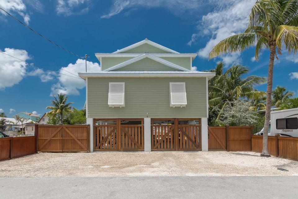 Частный односемейный дом для того Продажа на 9 Ventana Lane Big Coppitt, Флорида 33040 Соединенные Штаты