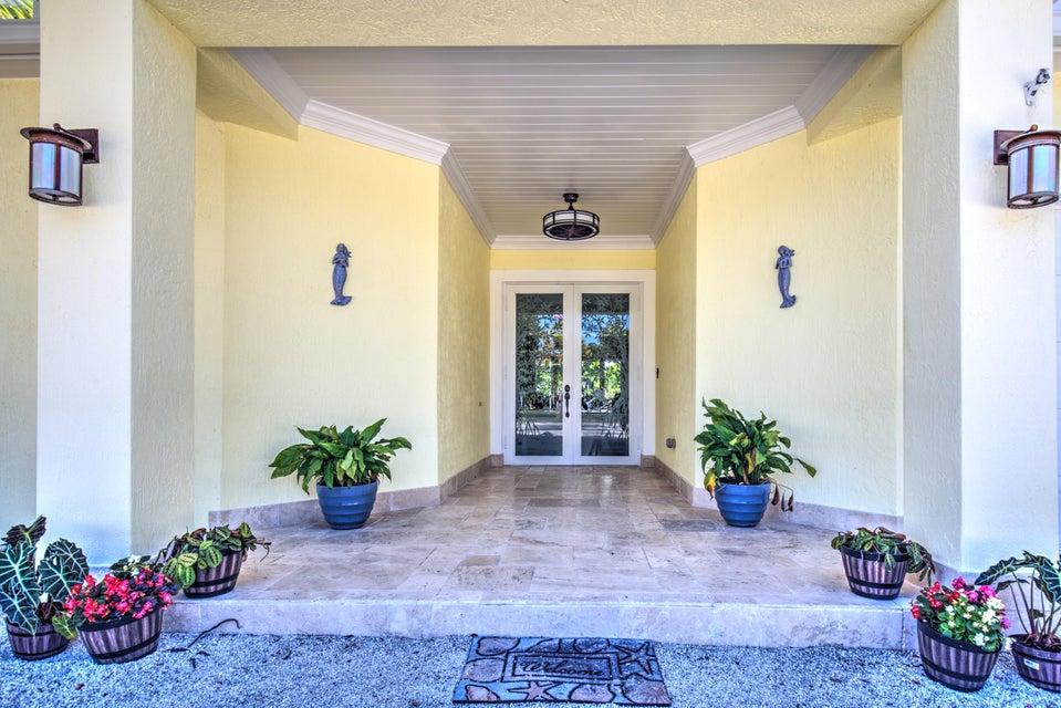 独户住宅 为 销售 在 103 Spoonbill Road 103 Spoonbill Road 塔威尼尔, 佛罗里达州 33070 美国