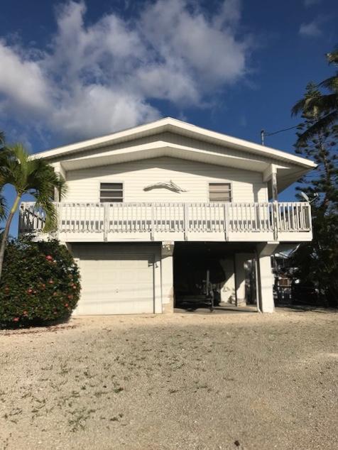 Casa para uma família para Venda às 1034 Adams Drive 1034 Adams Drive Key Largo, Florida 33037 Estados Unidos