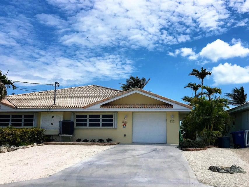 Vivienda unifamiliar por un Venta en 320 10Th Street 320 10Th Street Key Colony, Florida 33051 Estados Unidos