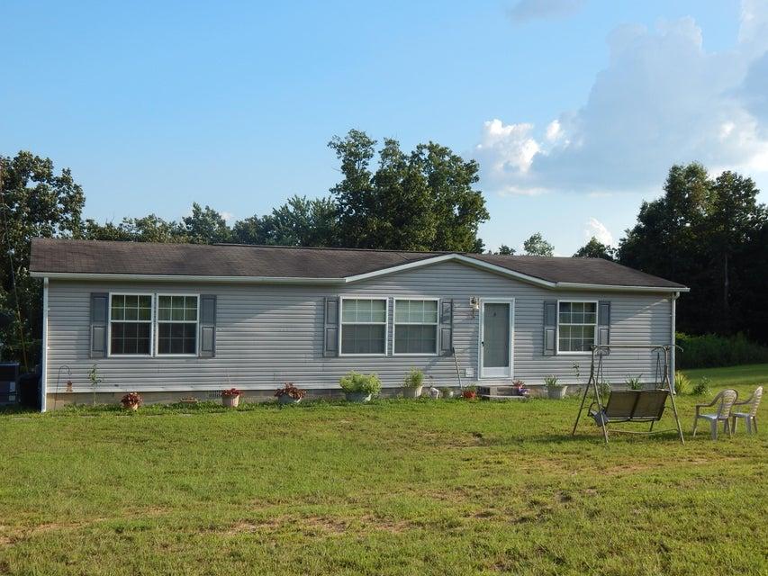 Maison unifamiliale pour l Vente à 1571 Coon Hollow Road Sunbright, Tennessee 37872 États-Unis