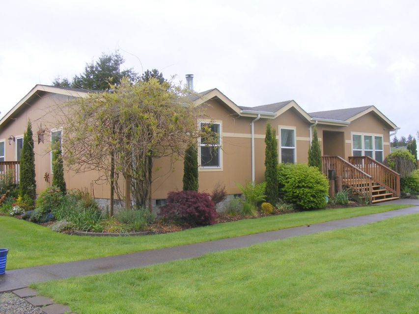 469 NW James Frank Ave, Siletz, OR 97380 - House exterior