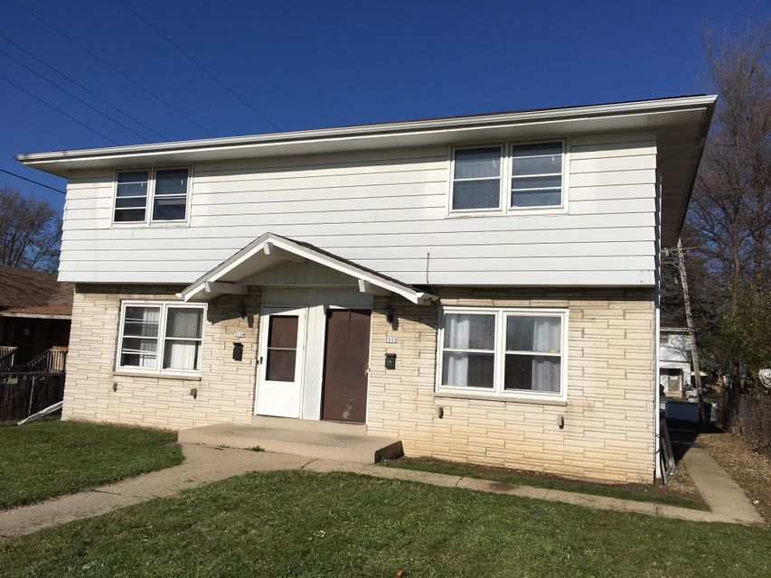 Two Family for Sale at 7112 W Mill Rd Milwaukee, Wisconsin 53218 United States