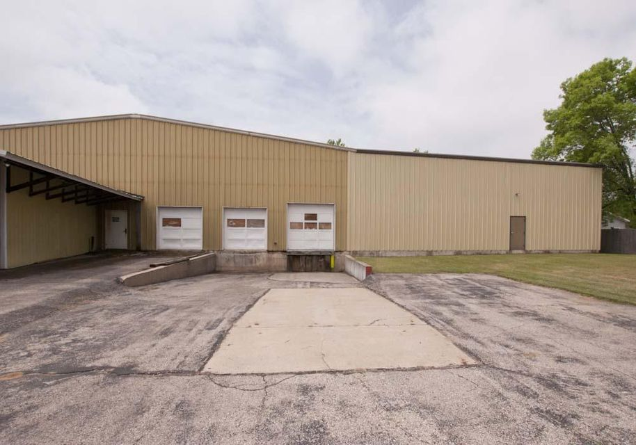 Peshtigo City Zoned Commercial Warehouses with 14,000 apx sq ft or under 19.00 per sq ft! Seller is considering all offers! Affordable, steel construction, wood construction, metal roofs, semi drive in capable, heated, office space, two bathrooms,  storage basement w/conveyor belt, large ceiling fans, concrete floors, several overhead doors and 32ft drive in cooler! Convenient location, plenty of green space for turning around semis and parking. More details in documents.