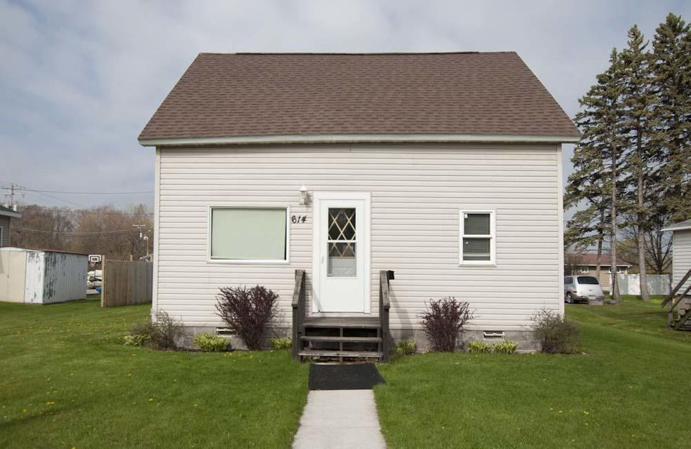 Completely renovated since 2010. Roof, insulation, siding, wiring, plumbing, foundation, interior walls, ceilings, bathrooms and kitchen.New flooring, painting and hot water heater in 2017. One bedroom on main level. Full bath and main floor laundry.  Half bath along with two bedrooms on upper level with a nook for a desk. Furnace and windows 2010. Turn key.