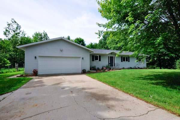 Affordable Country Living with Easy Maintenance. 4 Bedroom Country Ranch home with partially finished lower level. Private 1.54 acres with many trees fruit bearing trees, and berries. Garden area and a small greenhouse off two car attached garage. Newer roof, furnace, central air. Large kitchen with work island & bamboo floors. LR with large windows for viewing of wildlife. Master bath plus additional bath. Minutes from town. Come See TODAY!