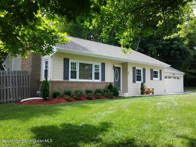 Photo of home for sale at 90 Shark River Road Road, Tinton Falls NJ