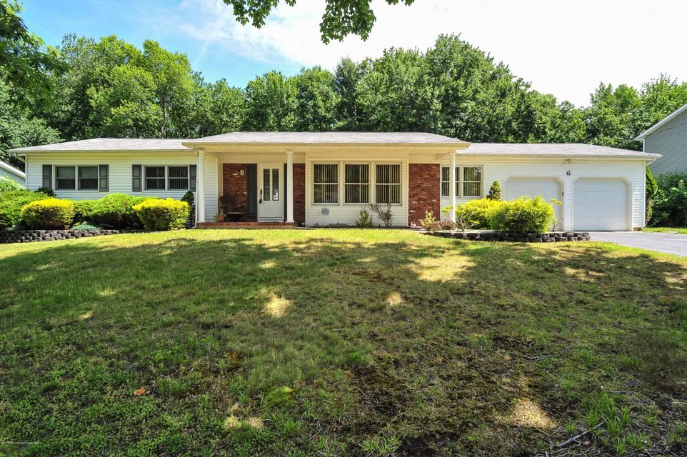 Photo of home for sale at 6 Guest Drive Drive, Morganville NJ