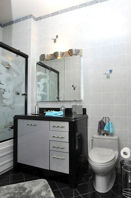 Attached Bath Tiled Floor to Ceiling