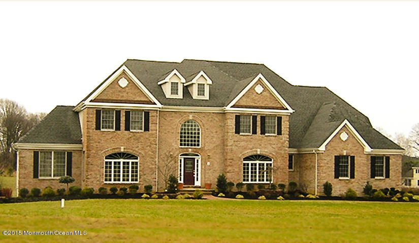 Photo of home for sale at 1 Cozy Drive Drive, Manalapan NJ