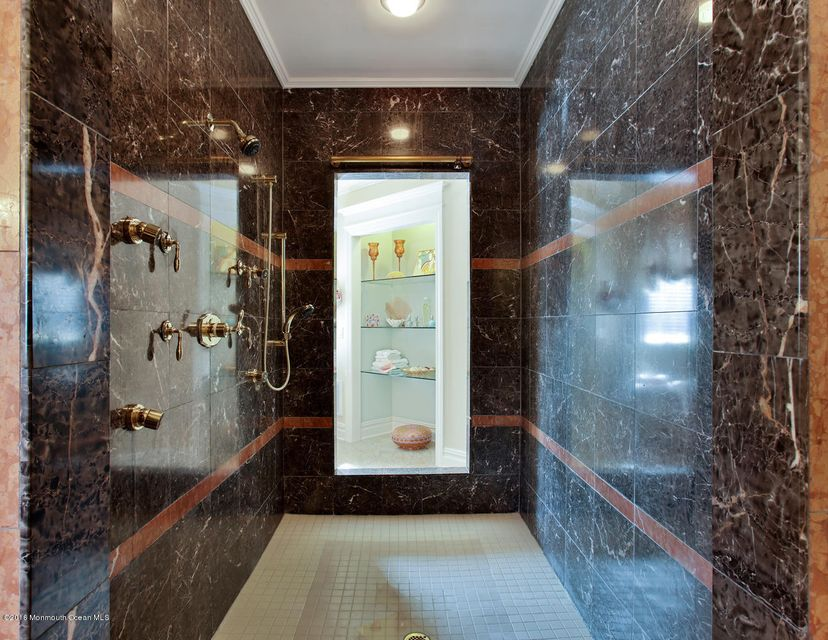 Walk in marble shower