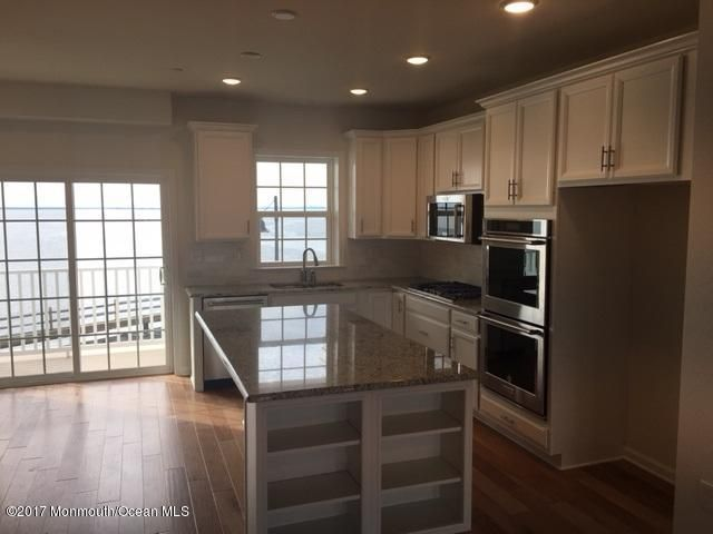 bright kitchen with stainless steel appl