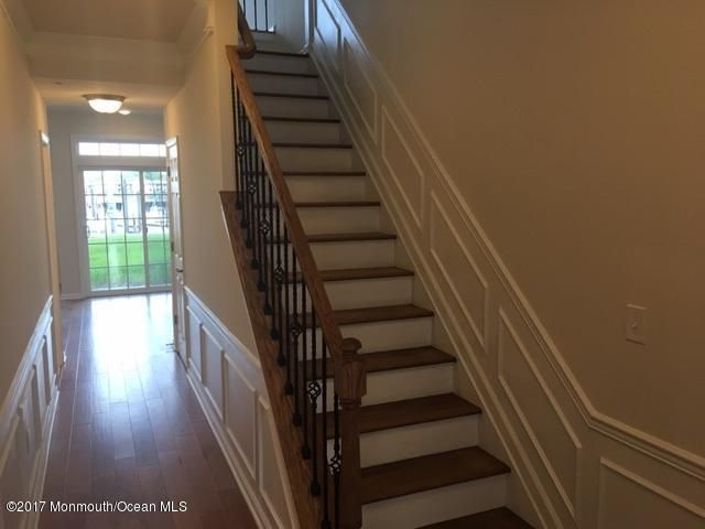 Entrance foyer with upgraded staircase a